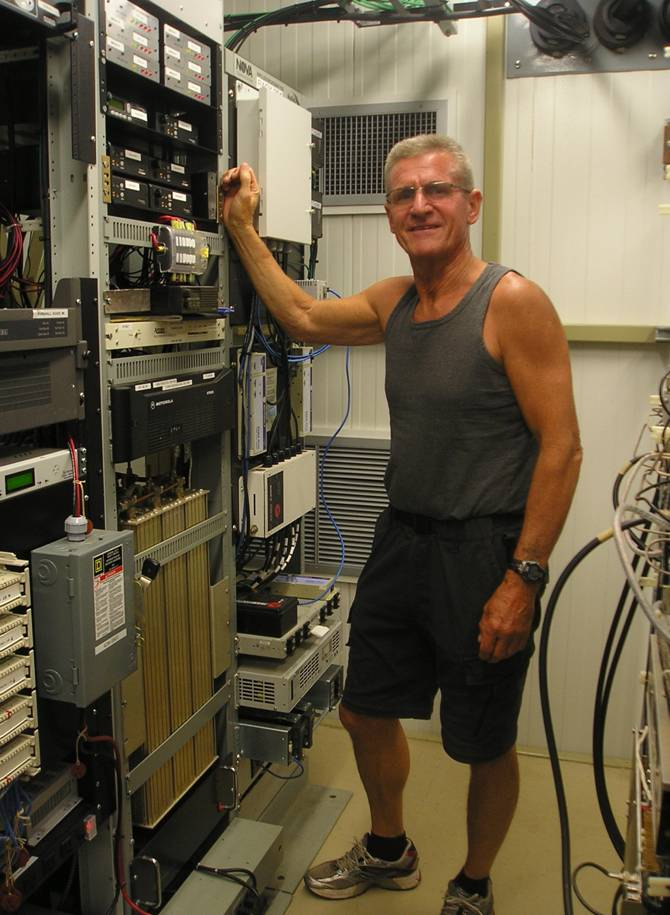 Brad VE1ZX working at a repeater site.
